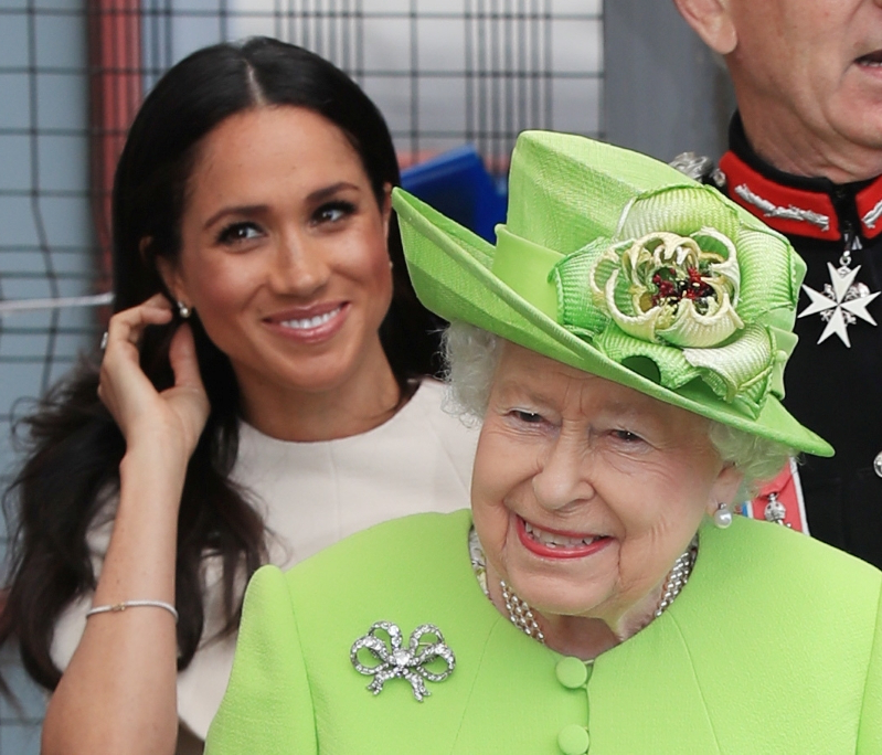 Queen Elizabeth 'recognizes how happy' Meghan Markle makes Prince Harry, book claims