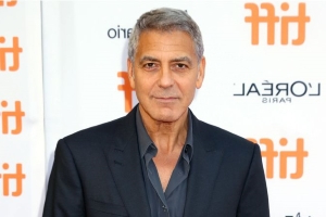 George Clooney Says Amal Banned Him from Motorcycles After 'Bad Accident' While Filming Catch-22
