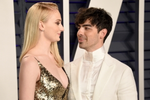 Sophie Turner bucked a big wedding tradition and wore a jumpsuit to marry Joe Jonas in a surprise Vegas ceremony