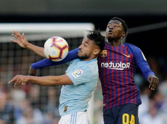 Makeshift Barcelona beaten at Celta, loses Dembele to injury