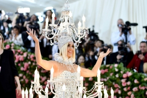 Katy Perry, wearing a 40-pound chandelier, is literally lit at the Met Gala