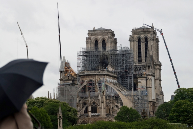 Paris Notre Dame cathedral rebuilding plans begin; fire-damaged landmark still attracts tourists