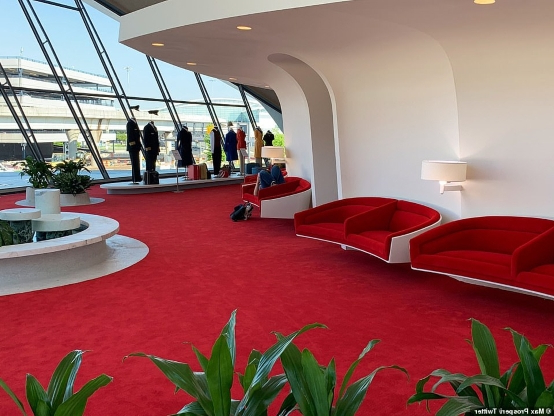 How the glamorous TWA Hotel has turned into a 'refuge' for delayed passengers: Guest slams management at the $300-a-night JFK Airport 'time capsule' for letting stranded travelers sleep in the lobby without paying
