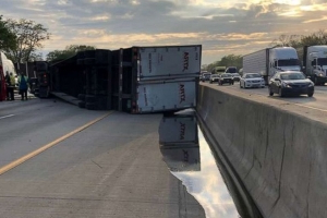 Truck carrying 41,000 pounds of honey overturns on highway