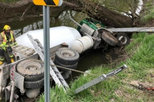 Driver rescued after cement truck plunges into creek in Wellesley
