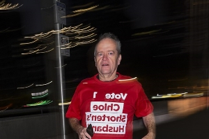 Vote for Chloe Shorten's husband! Bill takes morning jog dressed in tongue-in-cheek t-shirt before saying he is 'confident that Labor will win election'