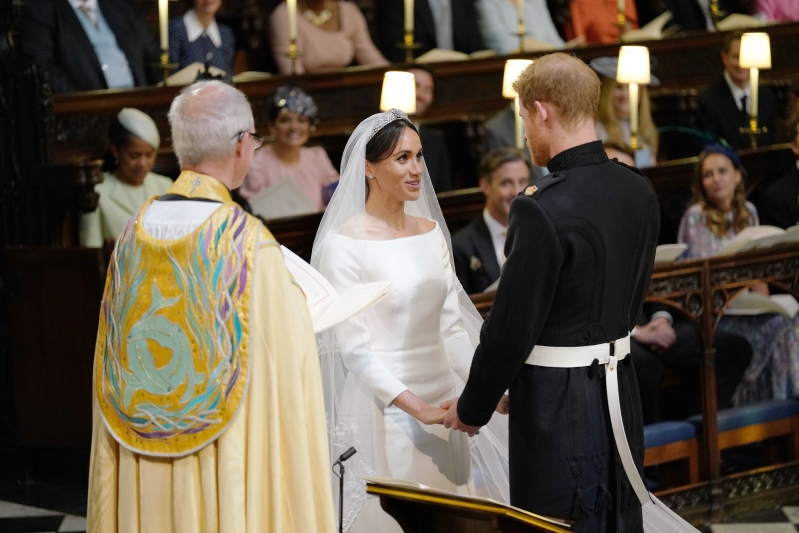 Meghan and Harry celebrate a year of marriage with sweet video showing unseen photos of their wedding - including sweet moment with Doria