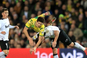 Timm Klose pens new Norwich deal