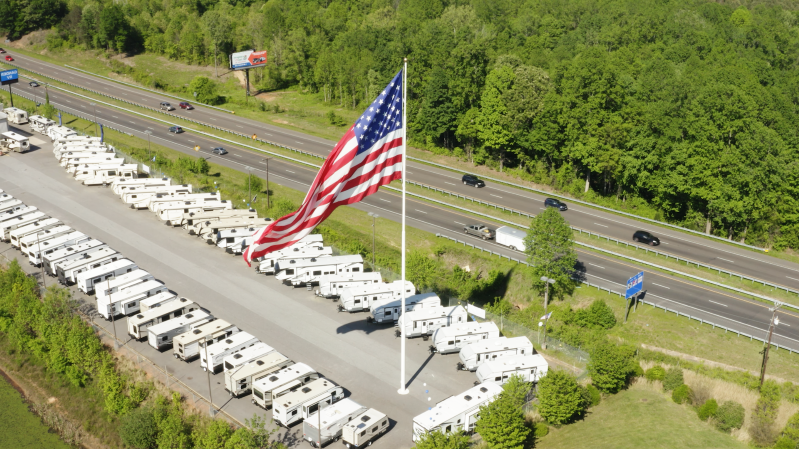 A North Carolina city is suing an RV retailer over its 'gigantic' American flag. They still won't take it down