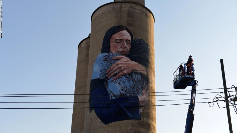 A painter has just revealed an 80-foot mural of New Zealand's prime minister comforting a woman