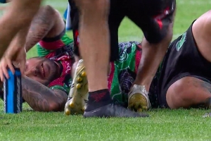 Rabbitohs v Wests Tigers: Adam Reynolds limps from field with possible leg fracture in Origin blow