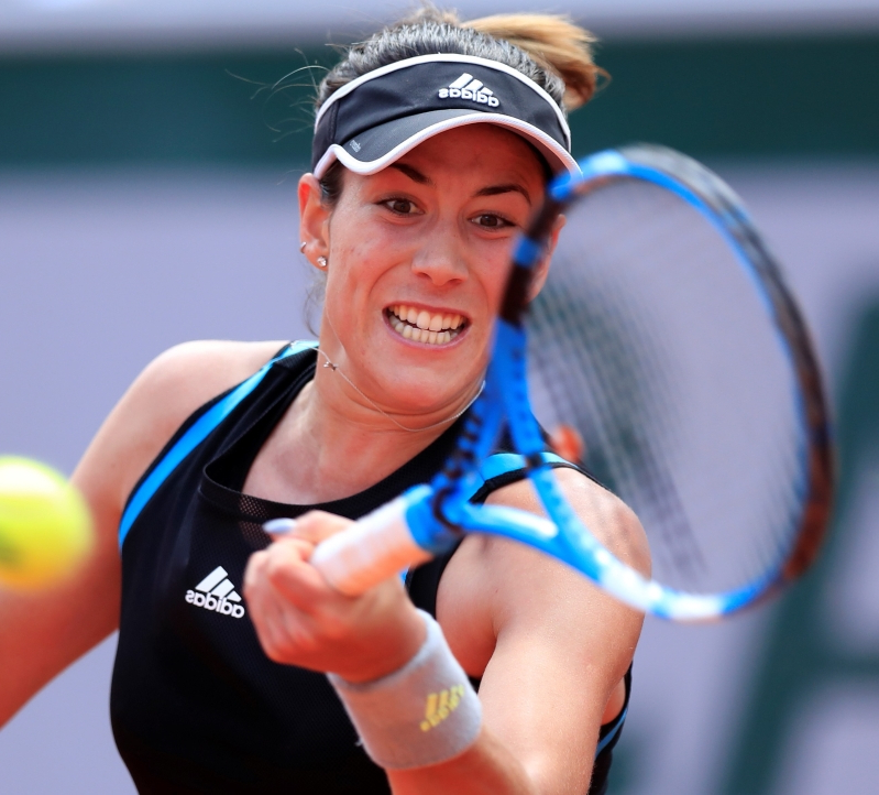 Tennis-Muguruza powers past Svitolina into French Open fourth round