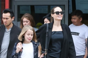 Angelina Jolie grins from ear-to-ear with her children by her side as the group goes shopping before lunch