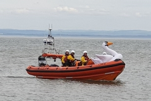 Two girls, five, are swept half a mile out to sea on an inflatable SWAN after one's father let go of the rope momentarily