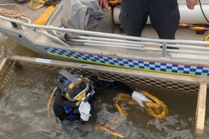 Body of NT gyrocopter pilot found after police search croc-infested river from cage