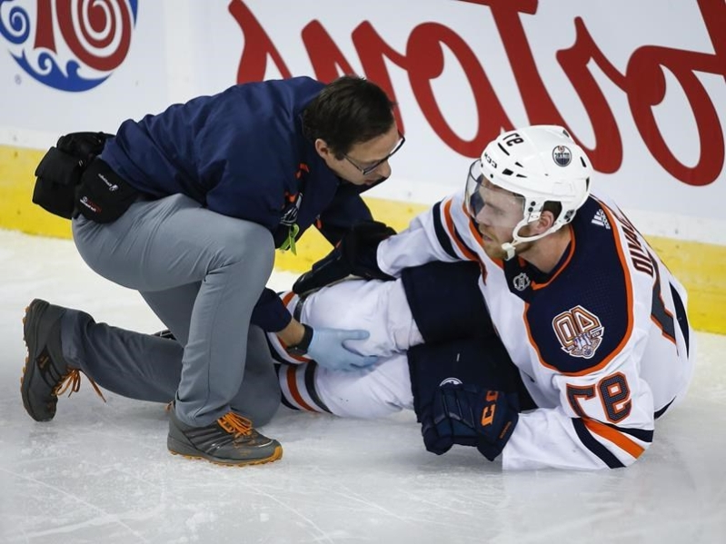 Sporting a brace, Oilers captain Connor McDavid mum on recovery from knee injury