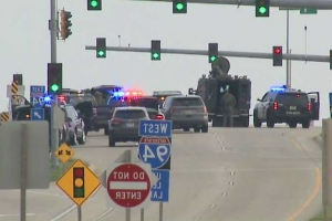 Two officer-involved shootings part of SWAT standoff, freeway closure