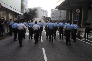 Hong Kong arrests 4 after bombs set off near police