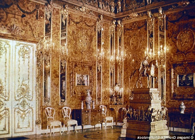 Does this hatch lead to Hitler's lost riches? Treasure hunters discover entrance hidden beneath a tree that they believe leads to bunker where £250million Amber Room is stashed