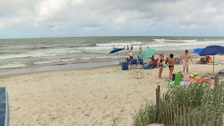 Teen wounded in possible shark attack while surfing