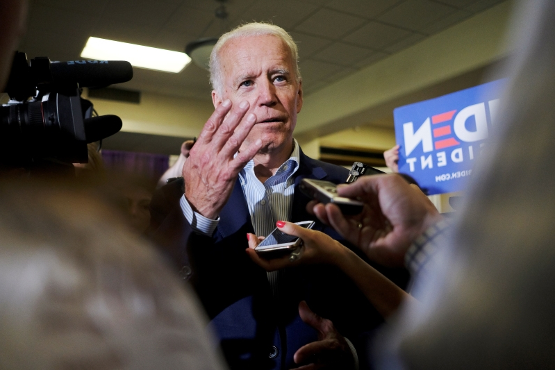 Biden and Trump exchange fire in Iowa, ignoring others in the field