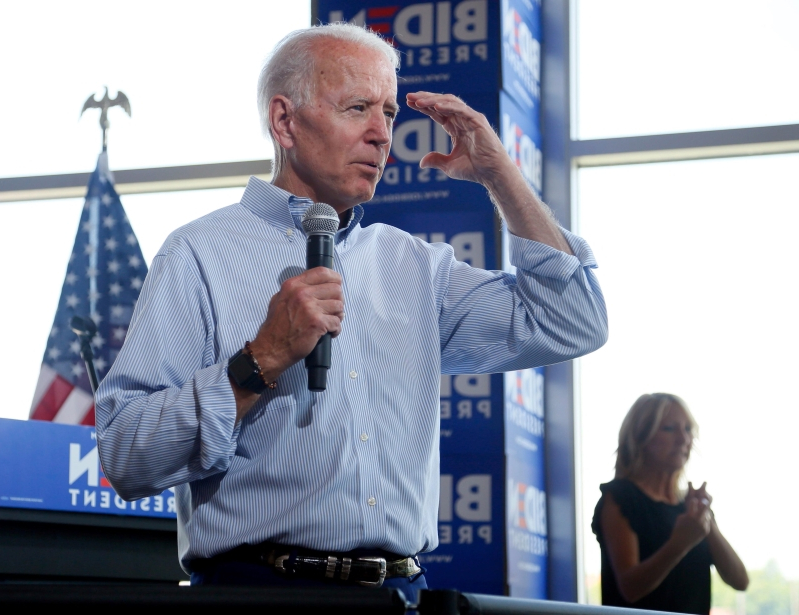 Joe Biden takes hard whacks at Donald Trump as both stump in Iowa
