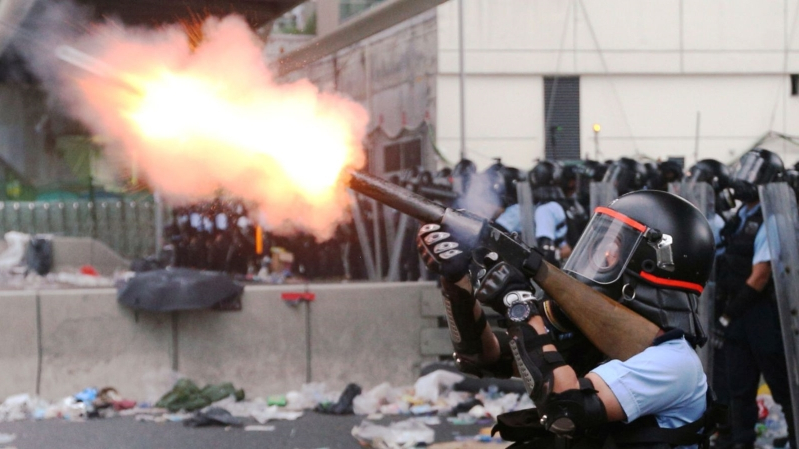 Panic spreads through Hong Kong protest as riot officers fire tear gas