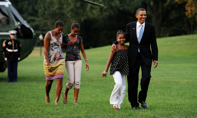 Sasha Obama graduates from high school with presidential parents looking on