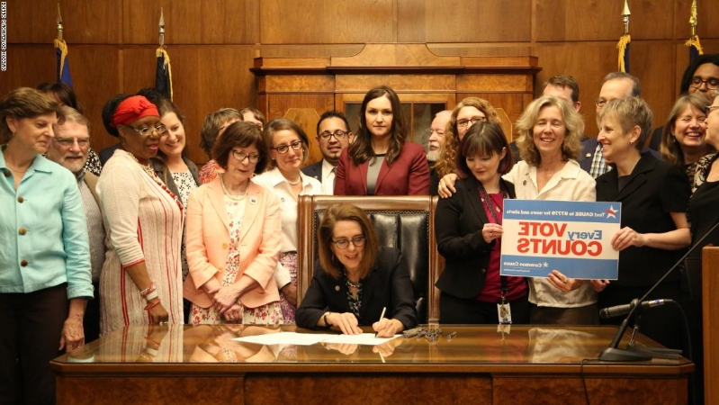 Oregon governor signs bill granting state's electoral votes to national popular vote winner