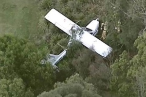 Two men escape with minor injuries after plane lands on golf course