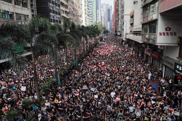 Hong Kong protesters return to streets; leader apologizes but doesn't withdraw extradition bill