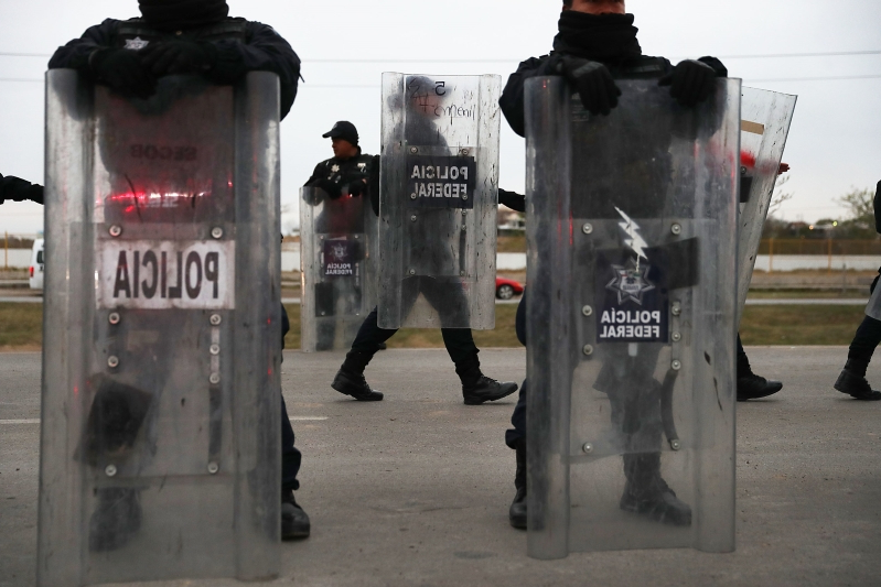 Migrants say police in Mexico opened fire on their truck, killing 19-year-old woman