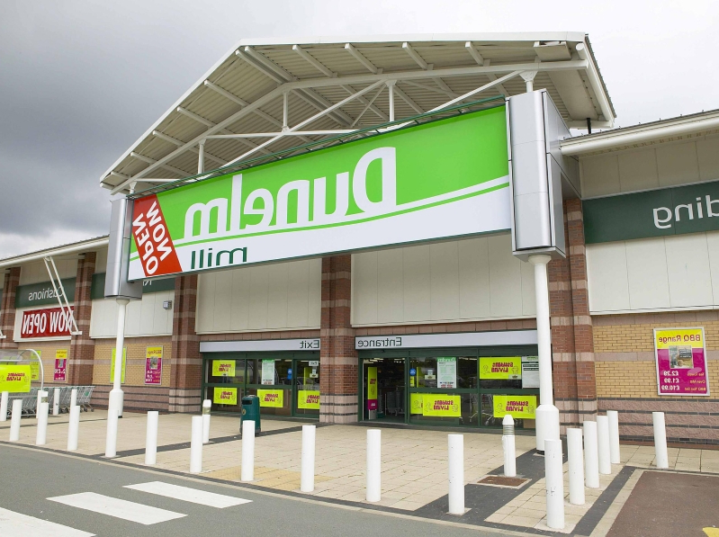 Dunelm ups profit outlook again as weather boosts sales
