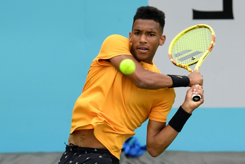 Felix Auger-Aliassime knocks off Dimitrov in Queen's Club opener