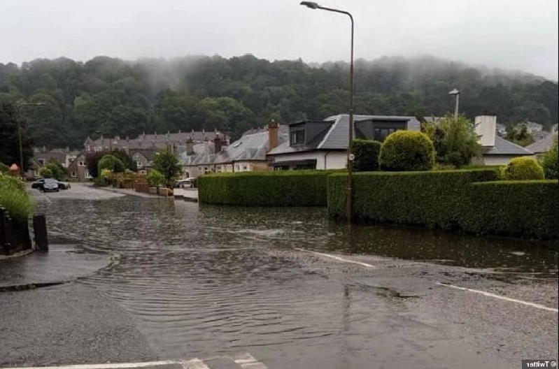Flash floods turn roads to rivers forcing drivers to abandon cars as a fortnight's rain falls in hours with more torrential downpours on way for southern Britain TONIGHT
