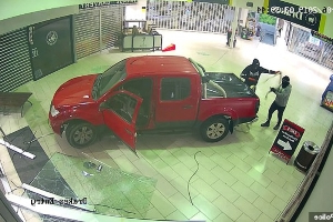 Smash, dash and no cash: Masked thugs reverse a red ute into a shopping complex before a clumsy attempt to make off with an ATM fails