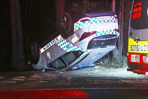 Cop car rolls during Gold Coast chase