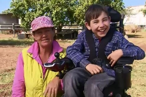Boy using wheelbarrow finally gets new wheelchair