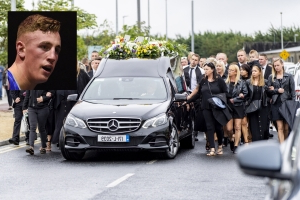 Heartbreaking scenes as boxing champ laid to rest
