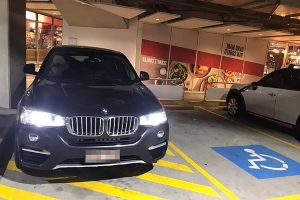 BMW driver's incredibly tone-deaf response after being called out for parking next to a disabled space
