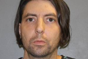 Hamden man arrested after allegedly trying to deflate tire of police car