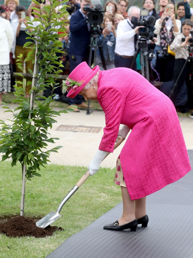'I'm still perfectly capable of planting a tree,' the Queen insists – and then does it
