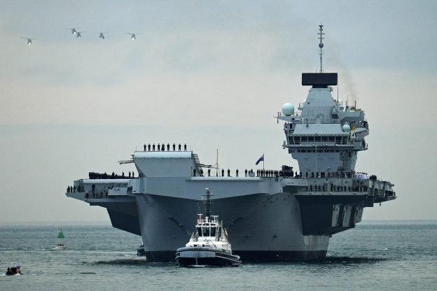 Leak probe launched on Big Lizzie! Navy investigate after Britain's largest warship is forced to limp back into port when water was found sloshing around inside