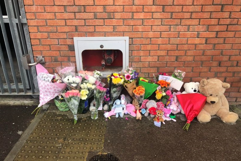 Neighbours leave flowers for tragic Santina Cawley, 2, as woman held in connection with her murder