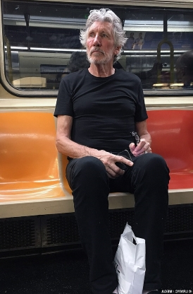Pink Floyd's Roger Waters, 75, goes unnoticed as he takes the subway in New York... despite being worth £247 MILLION