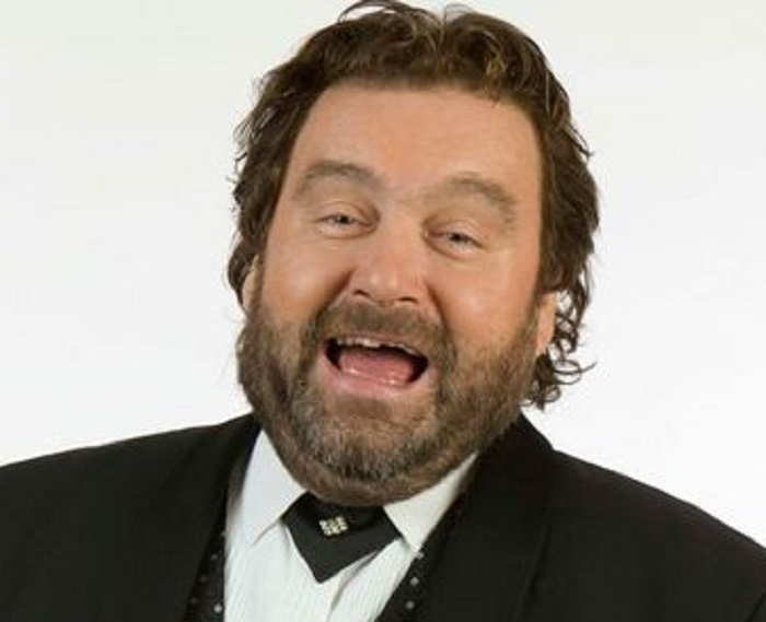 Famous faces from the worlds of entertainment, politics and sport join thousands at funeral of Brendan Grace