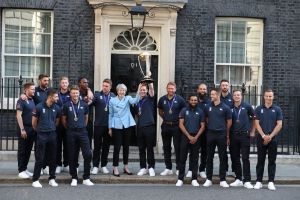 Theresa May raises a cup to England's cricket World Cup heroes