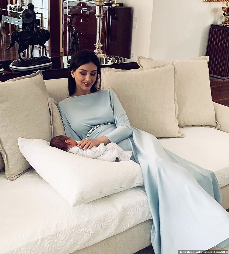 My fairy-tale royal marriage: Russian beauty queen who married Malaysian king reveals her very glamorous mothering-style - and how the couple got together