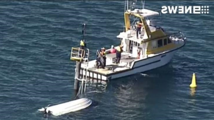 Australia: Cruiser barely afloat after high-speed crash into