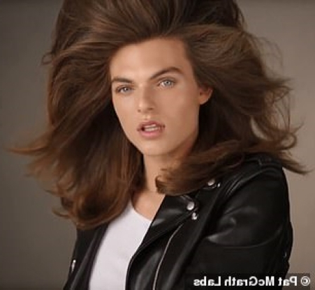 Liz Hurley's 17-year-old son Damian is the spitting image of his mother as he makes his modeling debut in a beauty campaign, showing off a picture-perfect pout while posing with HUGE hair and glowing highlighter